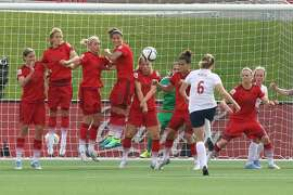 OTTAWA, ON - JUNE 11: Maren Mjelde #6 of Norway scores a goal on a direct kick as Annike Krahn #5, Saskia Bartusiak #3, Lena Goessling #20, Dzsenifer Marozsan #10, Tabea Kemme #22, Celia Sasic #13 and Alexandra Popp #18 try to defend against during the FIFA Women's World Cup Canada 2015 Group B match between Germany and Norway at Lansdowne Stadium on June 11, 2015 in Ottawa, Canada.  (Photo by Andre Ringuette/Getty Images)