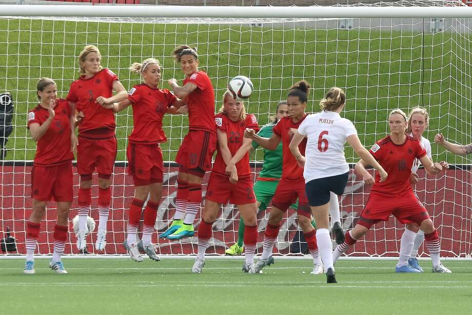 Norway's Maren Mjelde curls in a free kick to score against Germany in the 61st minute. The teams drew 1-1. Photo: Andre Ringuette, Getty Images