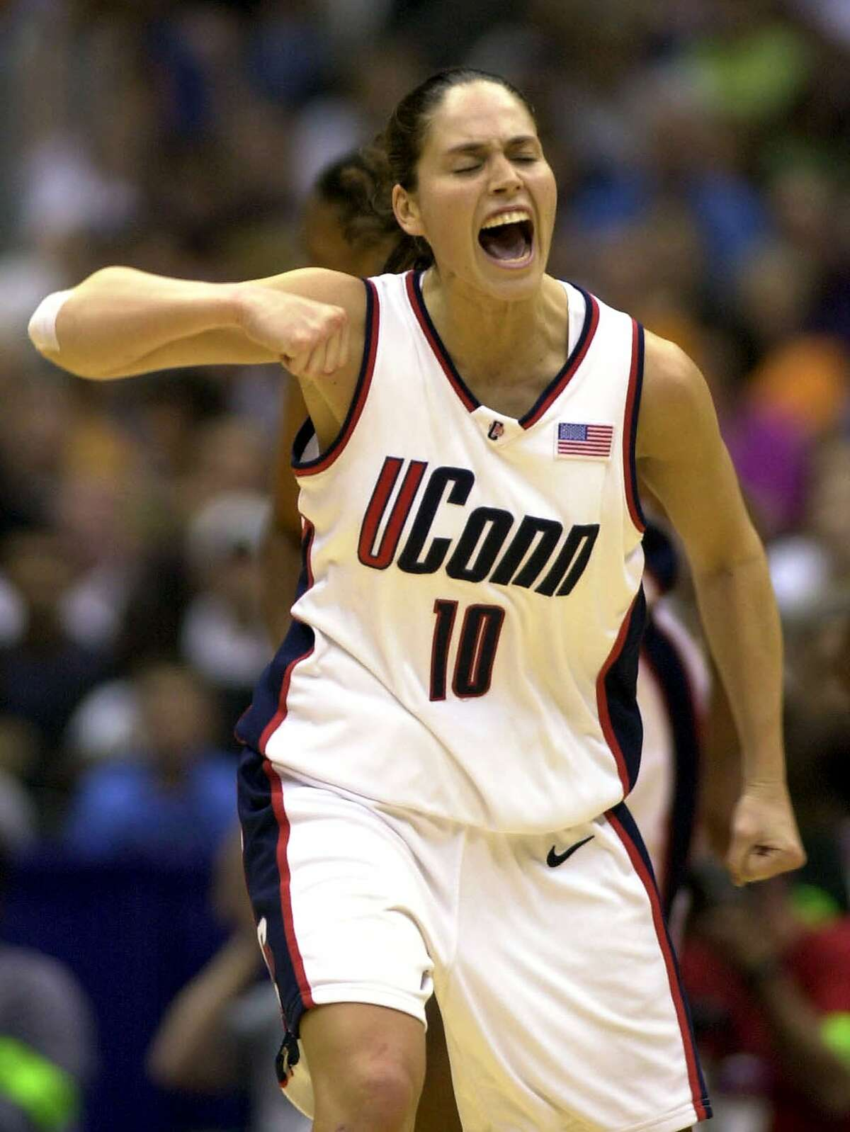 THEN During her four years (1999-02) at UConn, the Huskies posted a 136-9 record (.938), played in four NCAA Tournaments, won a pair of NCAA crowns (2000, 2002), advanced to the 2001 Final Four and earned four Big East Conference regular season and tournament titles. - usab.comPictured: Connecticut guard Sue Bird screams after a team scoring run in the second half against Tennessee, Friday, March 29, 2002, during a semifinal game at the NCAA Women's Final Four in San Antonio. (AP Photo/Eric Gay)