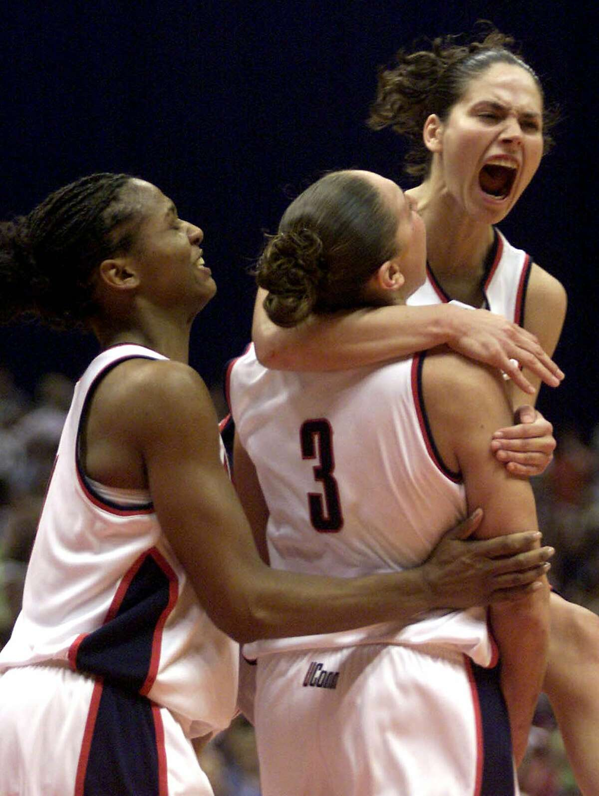 Pictured: Connecticuts's Tamika WIlliams, left, Diana Taurasi (3) and Sue Bird celebrate late in the second half against Oklahoma in UConn's 82-70 win in the NCAA Women's Final Four championship Sunday, March, 31, 2002, in San Antonio. (AP Photo/Donna McWilliam)