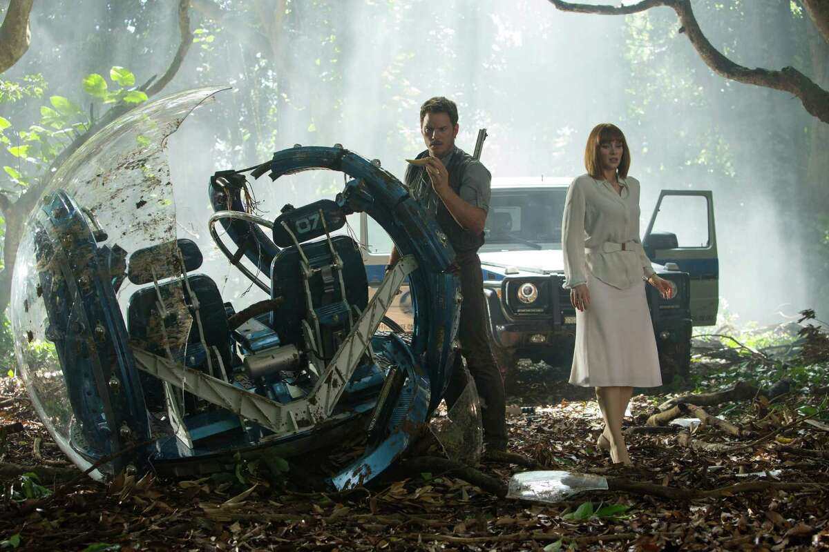"""This photo provided by Universal Pictures shows, Chris Pratt, left, and Bryce Dallas Howard in a scene from the film, """"Jurassic World,"""" directed by Colin Trevorrow, in the next installment of Steven Spielberg's groundbreaking """"Jurassic Park"""" series. The 3D movie releases in theaters by Universal Pictures on June 12, 2015. (Chuck Zlotnick/Universal Pictures via AP) ORG XMIT: CAE855"""