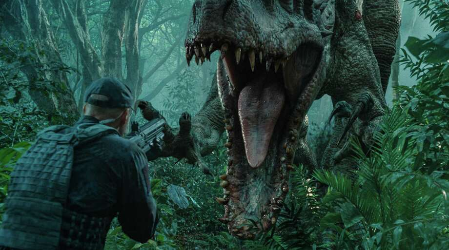 "This photo provided by Universal Pictures shows, Indominus Rex about to attack in a scene from the film, ""Jurassic World,"" directed by Colin Trevorrow, in the next installment of Steven Spielberg's groundbreaking ""Jurassic Park"" series. The Universal Pictures 3D movie releases in theaters on June 12, 2015. (ILM/Universal Pictures/Amblin Entertainment via AP) ORG XMIT: CAET793 Photo: ILM/Universal Pictures/Amblin Entert / Universal Pictures"