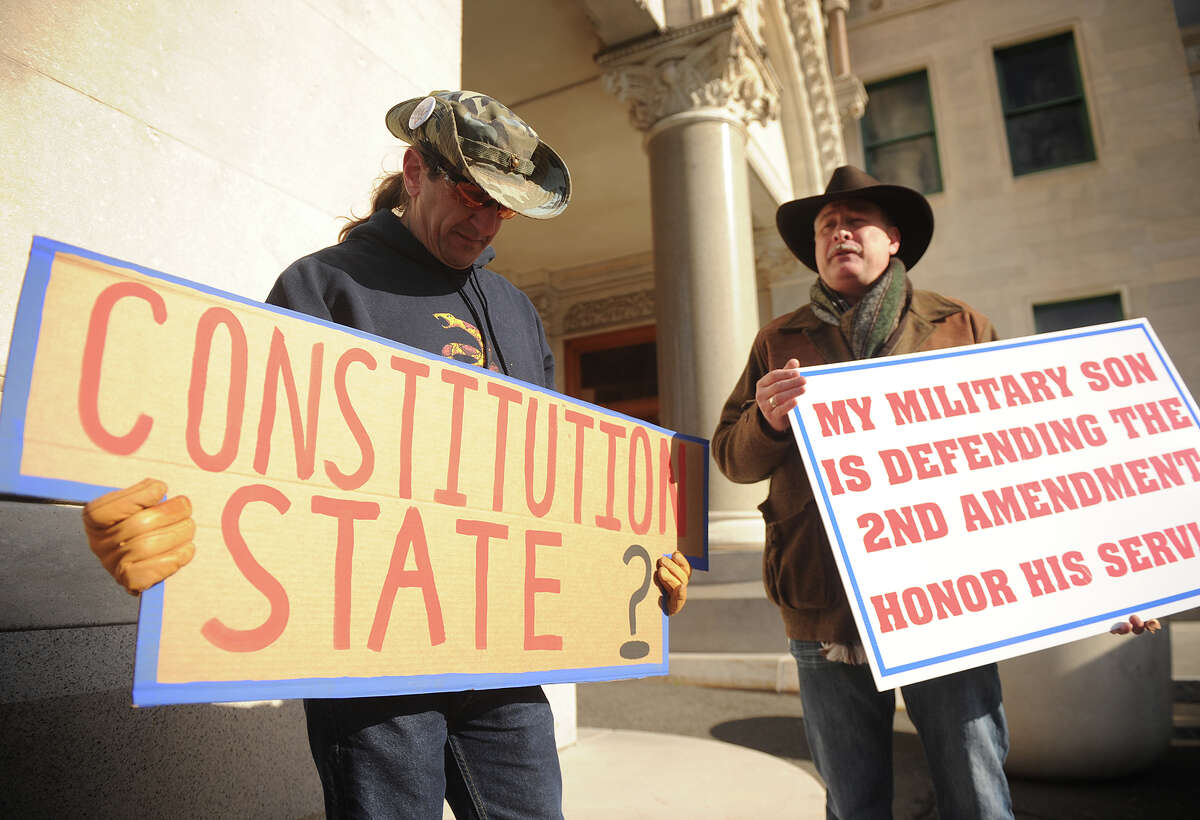 Gun-rights advocates Joel Klusek, left of Colchester, and Jody Winslow, of Farmington, protest the vote on gun-control legislation outside the Capitol in Hartford in 2013.