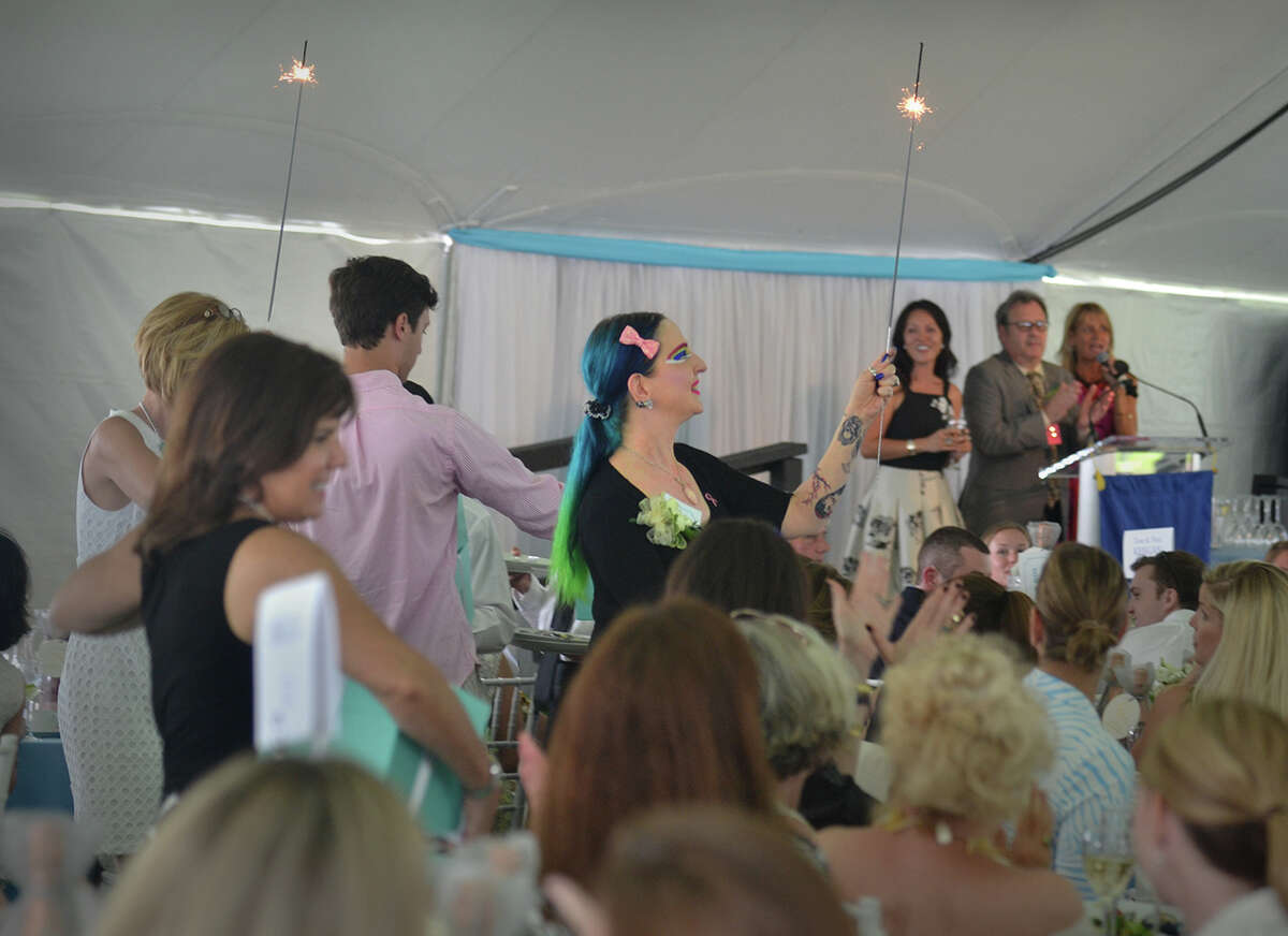 Campagne Joy, breast cancer survivor, leads fellow survivors around the tent at the Rose of Hope Luncheon on Thursday, June 11, 2015, in Fairfield, Conn.