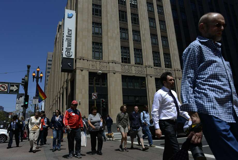 Pedestrians walk across 10th and Market Street in front of Twitter HQ in San Francisco, California, on Thursday, June 11, 2015. Photo: Brandon Chew, The Chronicle
