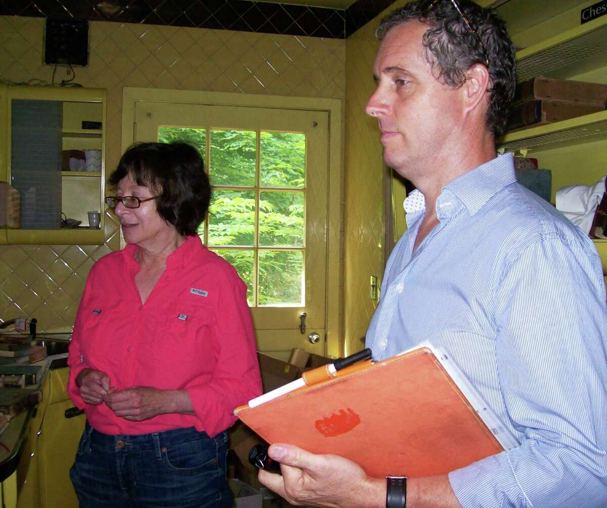 Selectman Helen Garten, left, and Morley Boyd, local historian, in the kitchen of Golden Shadows during a tour of the town-owned property.