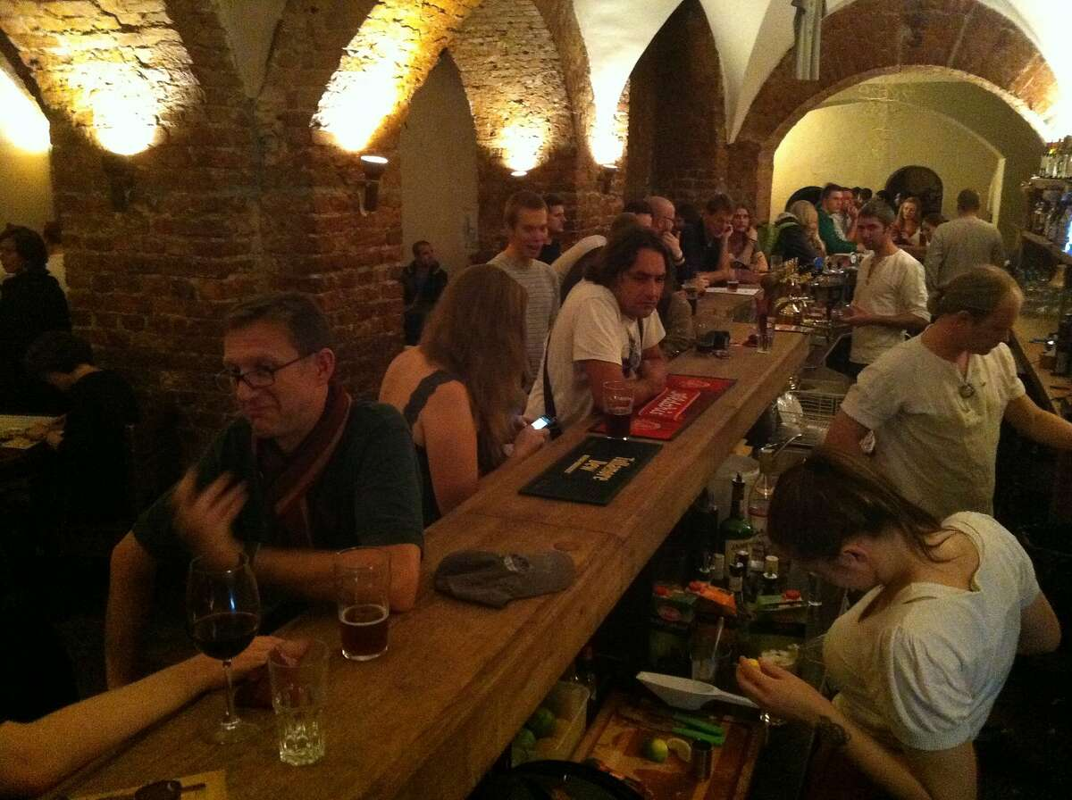"""Patrons enjoy drinks and Latvian music at Folkklubs ALA Pagrabs (""""in the Basement"""") in the Old Town part of Riga."""