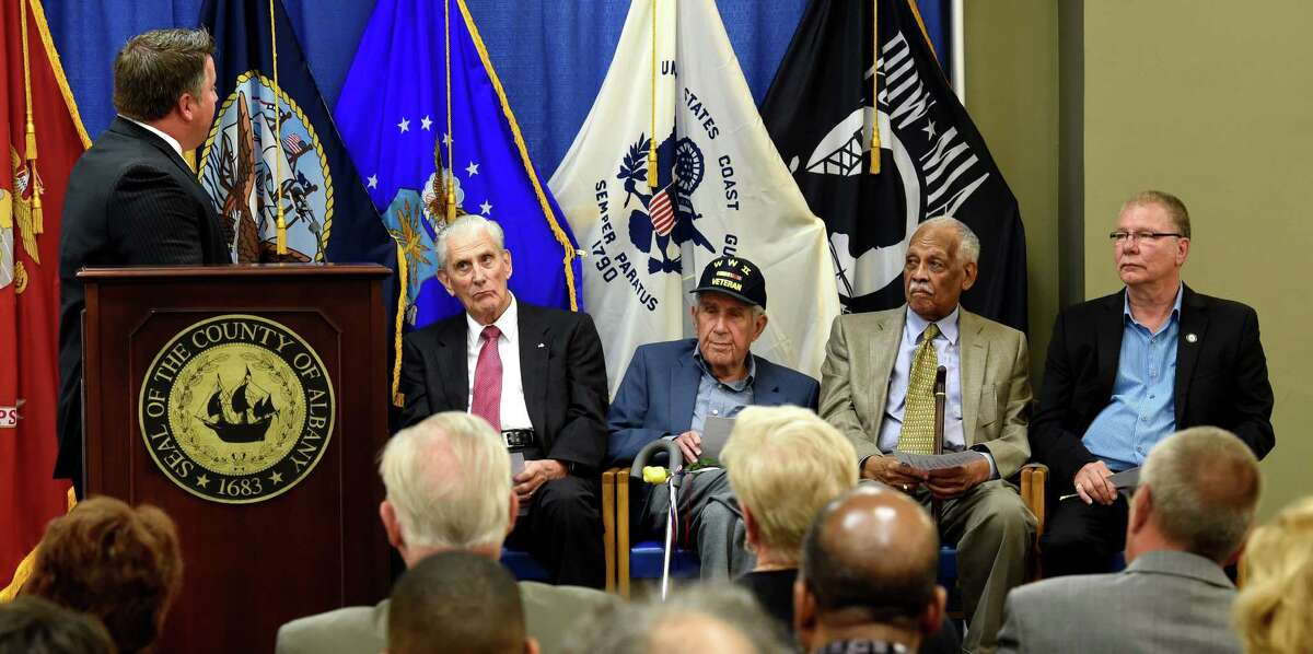 Albany County Executive Dan McCoy, left, acknowledges the honorees Thursday morning, June 11, 2015, during the Albany County Veterans Recognition Program at the Albany County building in Albany, N.Y. The honorees are; Hank Landau, left; Sol Greenberg, second from left; Peter Pryor, second from right and Joe Bruno, right. (Skip Dickstein/Times Union)