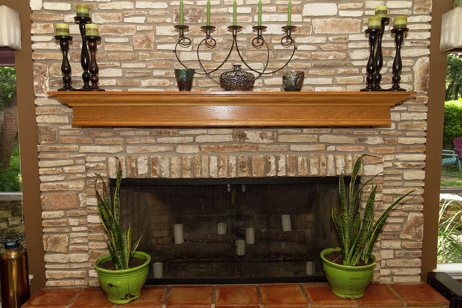 The mantel above the fireplace was built by homeowner David Helterbrand. Homeowners David and Rebecca Helterbrand have remodeled the home throughout the 14 years they have lived there. Photo: Alma E. Hernandez /For The Express-News