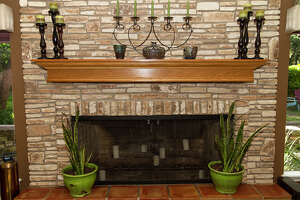 The mantel above the fireplace was built by homeowner David Helterbrand. Homeowners David and Rebecca Helterbrand have remodeled the home throughout the 14 years they have lived there.