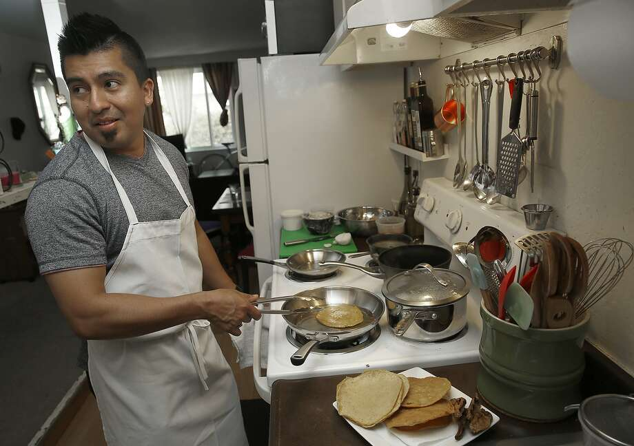 Chef Gonzalo Guzman of Nopalito fries tortillas for his chicken tostadas at home in San Francisco. Photo: Liz Hafalia, The Chronicle