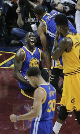 Golden State Warriors' Draymond Green reacts to foul in the first period during Game 4 of The NBA Finals between the Golden State Warriors and Cleveland Cavaliers at The Quicken Loans Arena on Thursday, June 11, 2015 in Cleveland, Ohio.