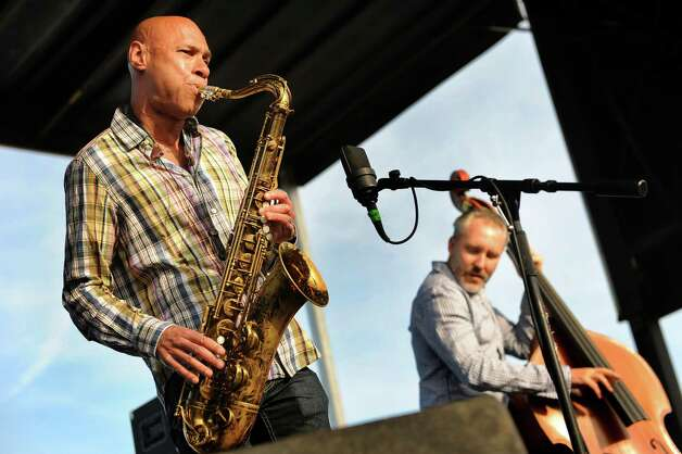 Saxophonist Joshua Redman performs with The Bad Plus Joshua Redman during the first Alive at Five concert of the summer season on Thursday, June 11, 2015, at Jennings Landing in Albany, N.Y. (Cindy Schultz / Times Union) Photo: Cindy Schultz / 00032223A
