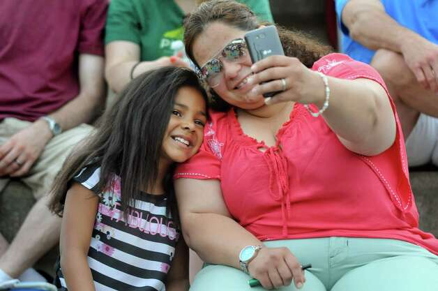 Theresa Borges of East Greenbush, right, records the moment with her daughter Nyla Mathurin, 6, at The Bad Plus Joshua Redman concert during Alive at Five on Thursday, June 11, 2015, at Jennings Landing in Albany, N.Y. (Cindy Schultz / Times Union) Photo: Cindy Schultz / 00032223A