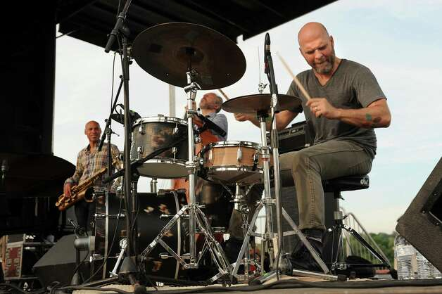 Drummer David King, right, performs with The Bad Plus Joshua Redman during Alive at Five on Thursday, June 11, 2015, at Jennings Landing in Albany, N.Y. (Cindy Schultz / Times Union) Photo: Cindy Schultz / 00032223A