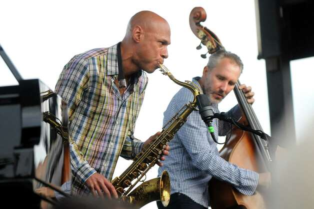 Saxophonist Joshua Redman. left, and bassist Reid Anderson of The Bad Plus perform during Alive at Five on Thursday, June 11, 2015, at Jennings Landing in Albany, N.Y. (Cindy Schultz / Times Union) Photo: Cindy Schultz / 00032223A