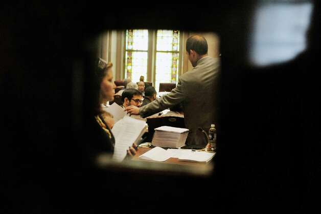 Senators and staff are seen through a small window in a door in the Senate lobby on Thursday, June 11, 2015, at the Capitol in Albany, N.Y.    (Paul Buckowski / Times Union)