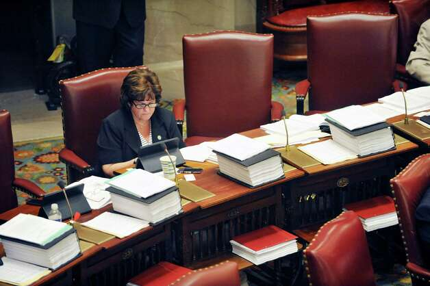 Senator Kathy Marchione works at her desk on the floor of the Senate chamber on Thursday, June 11, 2015, at the Capitol in Albany, N.Y.    (Paul Buckowski / Times Union)