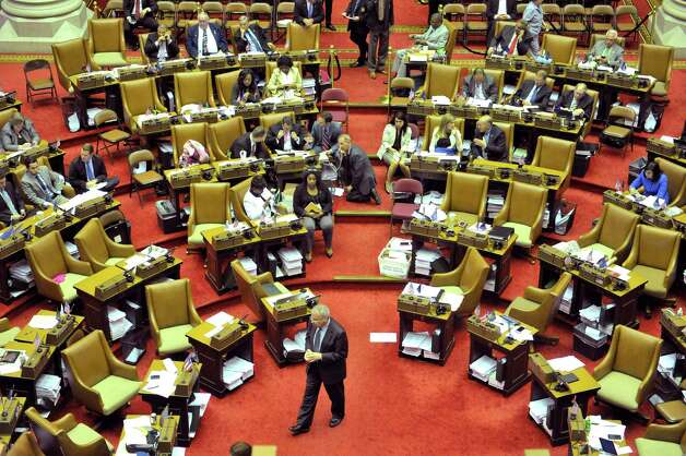 Assembly members and staff work in the chamber during session on Thursday, June 11, 2015, at the Capitol in Albany, N.Y.    (Paul Buckowski / Times Union)