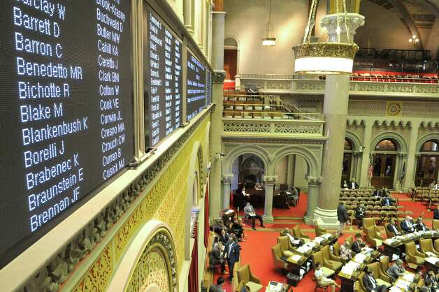 The names of Assembly members are seen on a vote tally board as they work during session on Thursday, June 11, 2015, at the Capitol in Albany, N.Y.    (Paul Buckowski / Times Union)