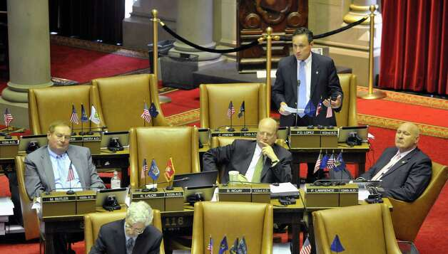 Assemblyman Peter Lopez rises to ask a question about the authorization of the education commissioner to appoint a monitor to oversee the East Ramapo Central School District during debate on the floor on Thursday, June 11, 2015, at the Capitol in Albany, N.Y.    (Paul Buckowski / Times Union)