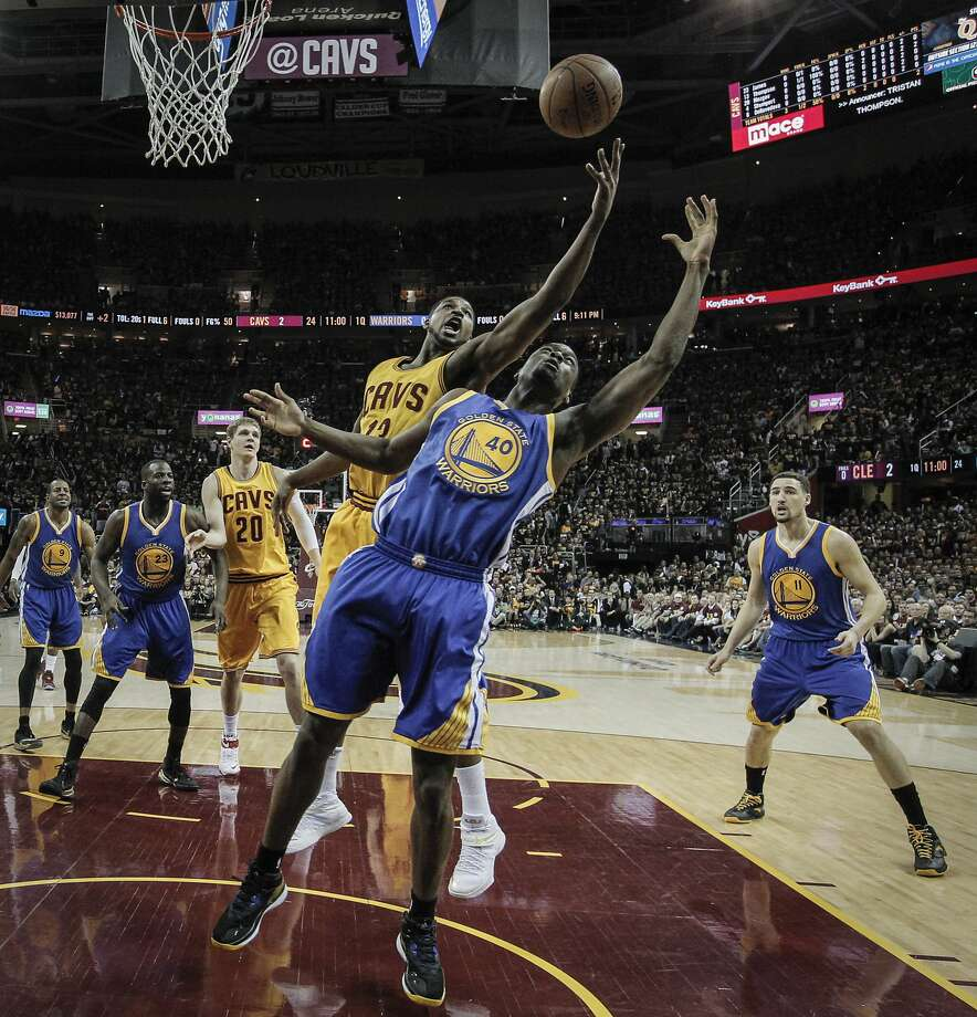 Cleveland Cavaliers' Tristan Thompson and Golden State Warriors' Harrison Barnes fight for a rebound in the first half during Game 4 of The NBA Finals between the Golden State Warriors and Cleveland Cavaliers at The Quicken Loans Arena on Thursday, June 11, 2015 in Cleveland, Ohio. Photo: Carlos Avila Gonzalez, The Chronicle