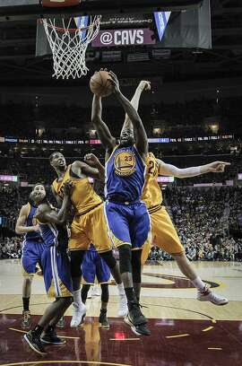 Golden State Warriors' Draymond Green pulls down a rebound in the first half during Game 4 of The NBA Finals between the Golden State Warriors and Cleveland Cavaliers at The Quicken Loans Arena on Thursday, June 11, 2015 in Cleveland, Ohio.