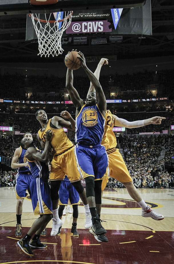 Golden State Warriors' Draymond Green pulls down a rebound in the first half during Game 4 of The NBA Finals between the Golden State Warriors and Cleveland Cavaliers at The Quicken Loans Arena on Thursday, June 11, 2015 in Cleveland, Ohio. Photo: Carlos Avila Gonzalez, The Chronicle