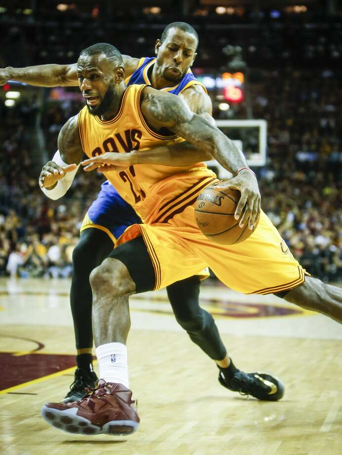 Golden State Warriors' Andre Iguodala tries to stop Cleveland Cavaliers' LeBron James in the third period during Game 4 of The NBA Finals between the Golden State Warriors and Cleveland Cavaliers at The Quicken Loans Arena on Thursday, June 11, 2015 in Cleveland, Ohio. Photo: Scott Strazzante, The Chronicle