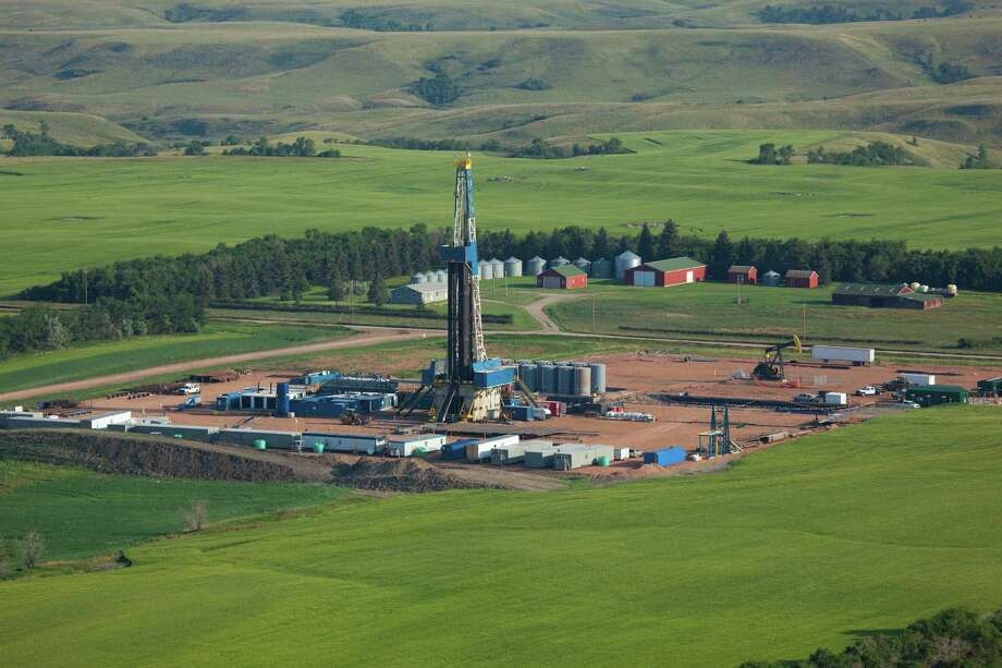 A Hess Corp. drilling rig operates in North Dakota's Bakken Shale, where the company also has transportation and processing infrastructure that it will operate in a new joint venture with Global Infrastructure Partners.   (Hess photo) Photo: Hess / Copyright 2012