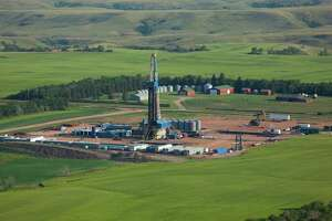 A Hess Corp. drilling rig operates in North Dakota's Bakken Shale, where the company also has transportation and processing infrastructure that it will operate in a new joint venture with Global Infrastructure Partners.   (Hess photo)