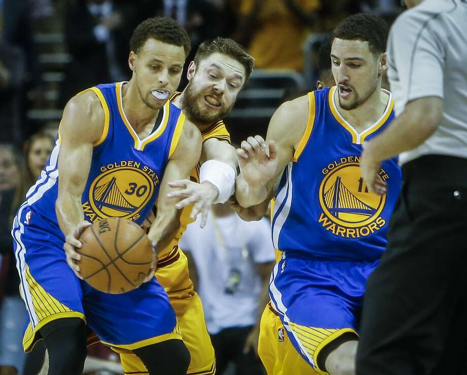 Cleveland Cavaliers' Matthew Dellavedova tries to knock the ball away from Golden State Warriors' Stephen Curry in the third period during Game 4 of The NBA Finals between the Golden State Warriors and Cleveland Cavaliers at The Quicken Loans Arena on Thursday, June 11, 2015 in Cleveland, Ohio. Photo: Scott Strazzante, The Chronicle