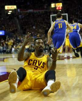Cleveland Cavaliers' J.R. Smith reacts to a non-call as Golden State Warriors head upcourt in 4th quarter of Warriors' 103-82 win during Game 4 of NBA Finals' at Quicken Loans Arena in Cleveland, Ohio, on Thursday, June 11, 2015.