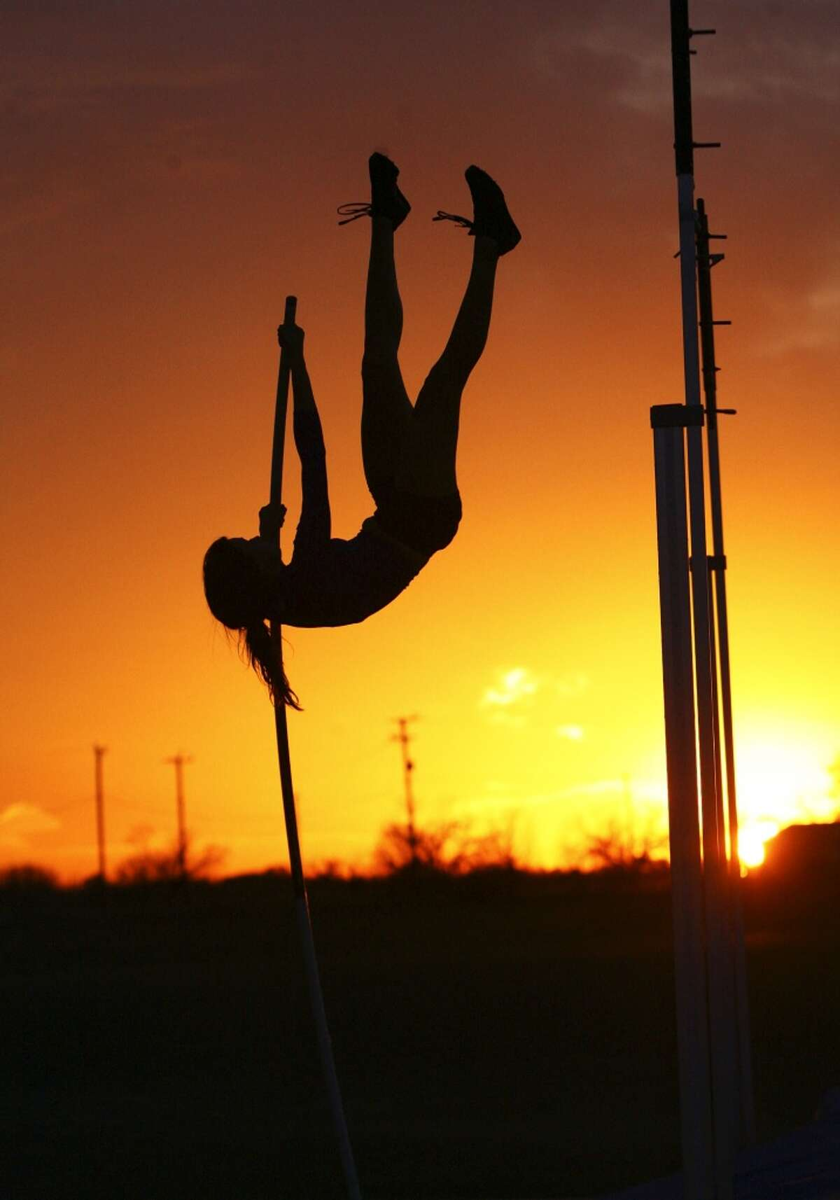 SPORTS Demi Payne, from New Braunfels High School, practices her technique in pole vaulting at Jim Dickson's Elite Vaulter Sports Complexnear St. Hedwig Wednesday at sunset. Tom Reel/Staff February 18, 2009.