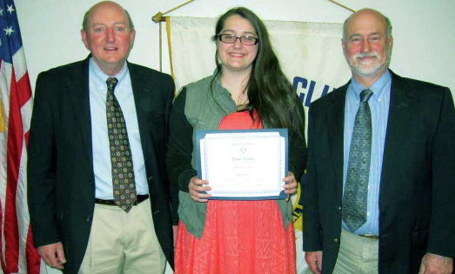 NMHS senior Amber Levine recently was honored by the Rotary Club of New Milford as its New Milford High School Student of the Month for April. Among those on hand to help honor Amber were Rotarian Rob Belden, left, and NMHS music teacher and choral director Bob Keck. Amber is a member of the NMHS chapter of the National Honor Society and the Spanish Honor Society, serves on NAMES' steering committee and is president of the school Dramatics Club. She has annually participated in the all-school musicals and school carnivals and enjoys singing, acting and sketching in her spare time. Amber plans to enter Western Connecticut State University in Danbury in the fall, with double majors in theater arts and secondary math education. Photo: Contributed Photo / Contributed Photo / The News-Times Contributed
