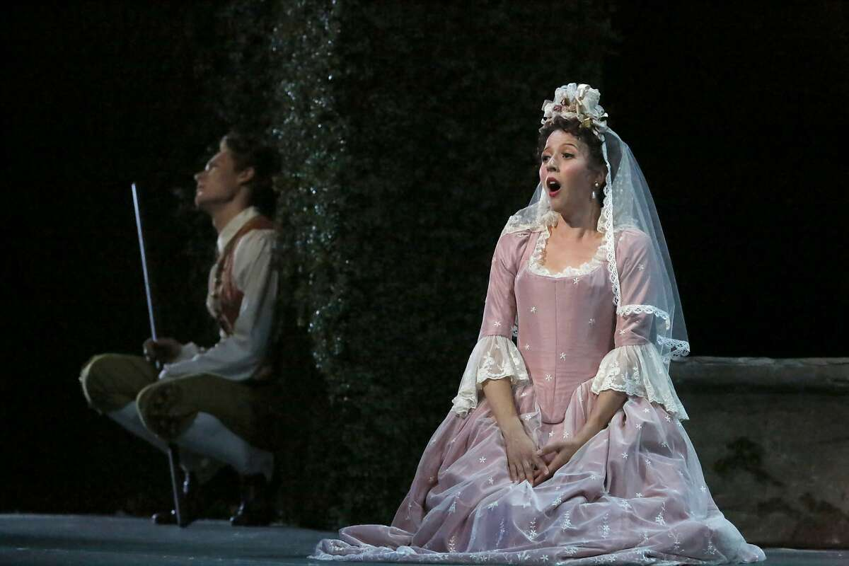 """Philippe Sly as Figaro (l to r) and Lisette Oropesa as Susanna are seen during final dress rehearsal for San Francisco Opera's """"The Marriage of Figaro"""" on Thursday, June 11, 2015 in San Francisco, Calif."""