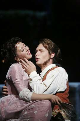 "Lisette Oropesa (l to r) as Susanna and Philippe Sly as Figaro perform during final dress rehearsal for San Francisco Opera's ""The Marriage of Figaro"" on Thursday, June 11, 2015 in San Francisco, Calif."