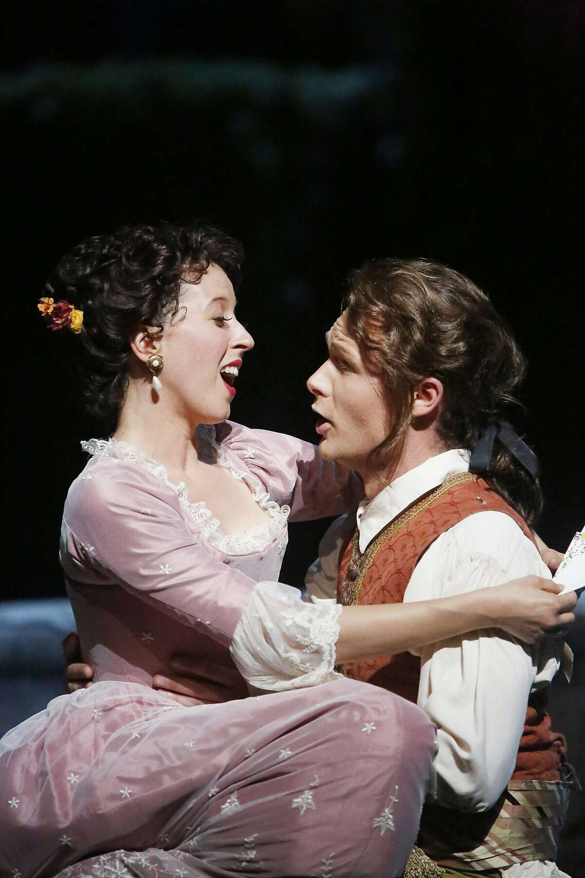 """Lisette Oropesa (l to r) as Susanna and Philippe Sly as Figaro perform during final dress rehearsal for San Francisco Opera's """"The Marriage of Figaro"""" on Thursday, June 11, 2015 in San Francisco, Calif."""