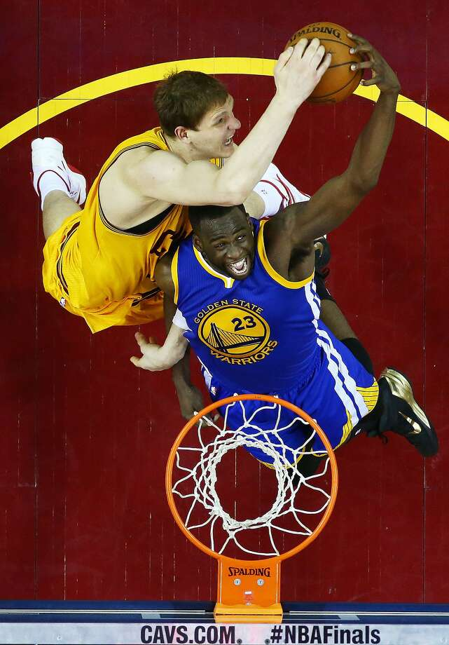 CLEVELAND, OH - JUNE 11:  Timofey Mozgov #20 of the Cleveland Cavaliers goes up against Draymond Green #23 of the Golden State Warriors in the second half during Game Four of the 2015 NBA Finals at Quicken Loans Arena on June 11, 2015 in Cleveland, Ohio.  NOTE TO USER: User expressly acknowledges and agrees that, by downloading and or using this photograph, user is consenting to the terms and conditions of Getty Images License Agreement.  (Photo by Ronald Martinez/Getty Images) Photo: Ronald Martinez, Getty Images