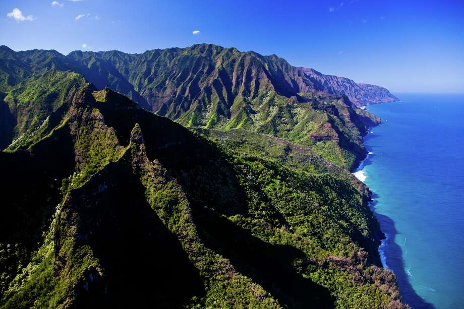 The soaring sea cliffs of the  Napali Coast are now accessible for hikers with the reopening of the Kalalau trail on Kauai's north shore. Photo: Tor Johnson / HTA