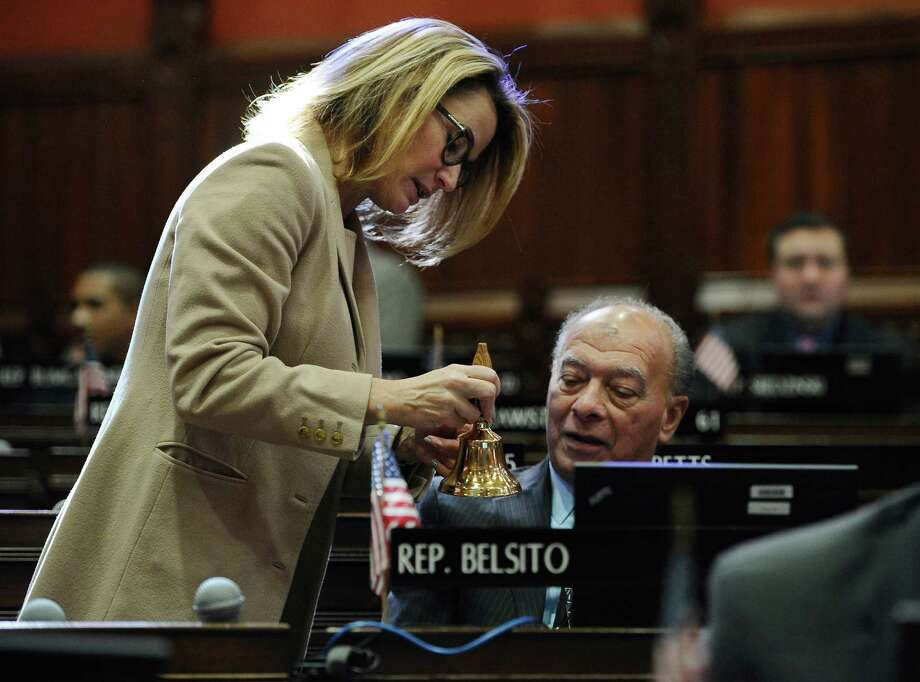 State House Minority Leader Themis Klarides, R-Derby, left, shows a bell to State Rep. Sam Belsito, R-Tolland before Gov. Dannel P. Malloy's budget address at the state Capitol, Wednesday, Feb. 18, 2015, in Hartford, Conn. Photo: Jessica Hill / AP Photo/Jessica Hill / Associated Press