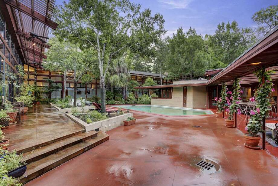 A home designed by famed, influential architect Frank Lloyd Wright is back on the market here in Houston for just under $3 million. Known as the Thaxton House, this is the only FLW home of its kind in Houston, making it especially unique. The home in the Bunker Hill area boasts seven bedrooms and six and a half bathrooms, plus plenty of foliage around it to forget you are located in the third-largest city in the country. Photo: HAR / TK Images, Bill Krampitz