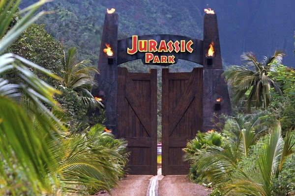 """Although the original sign is long gone, the fencepoles erected to create the """"Jurassic Park"""" gates for the 1993 movie still stand on an unpaved road in the East Kauai watershed, where daring hikers try to clamber their way to Mount Waialeale's """"Blue Hole."""""""