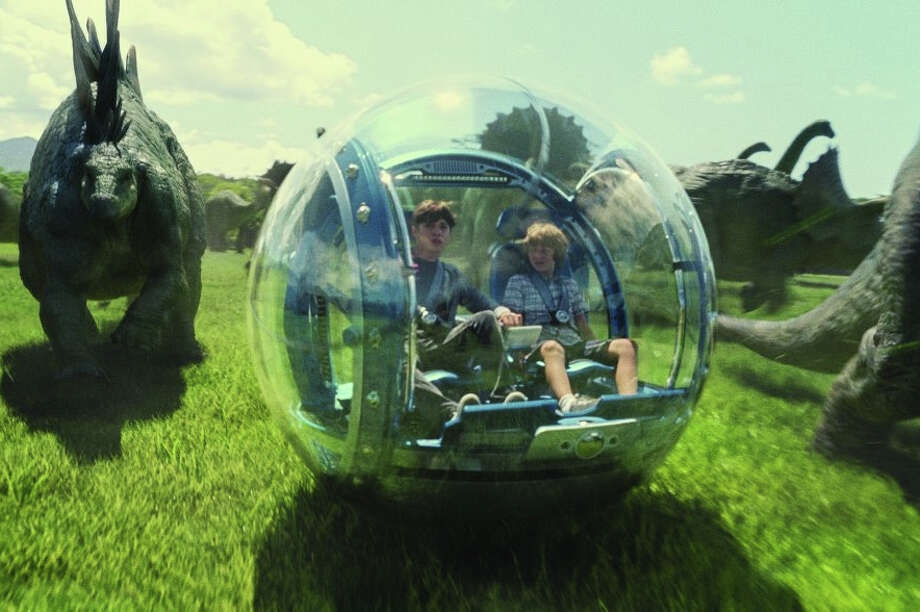 """Ty Simpkins and Nick Robinson travel with a pack of dinosaurs in """"Jurassic World,""""  opening June 12 as the fourth installment in Steven Spielberg's franchise, which debuted in 1993. Like its predecessors, the film features many scenes shot on Kauai and Oahu. Photo: Chuck Zlotnick / Universal Pictures"""