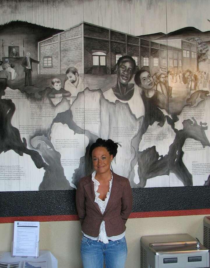 Rachel Dolezal displays a mural she painted in Idaho. Photo: Nicholas K. Geranios, Associated Press