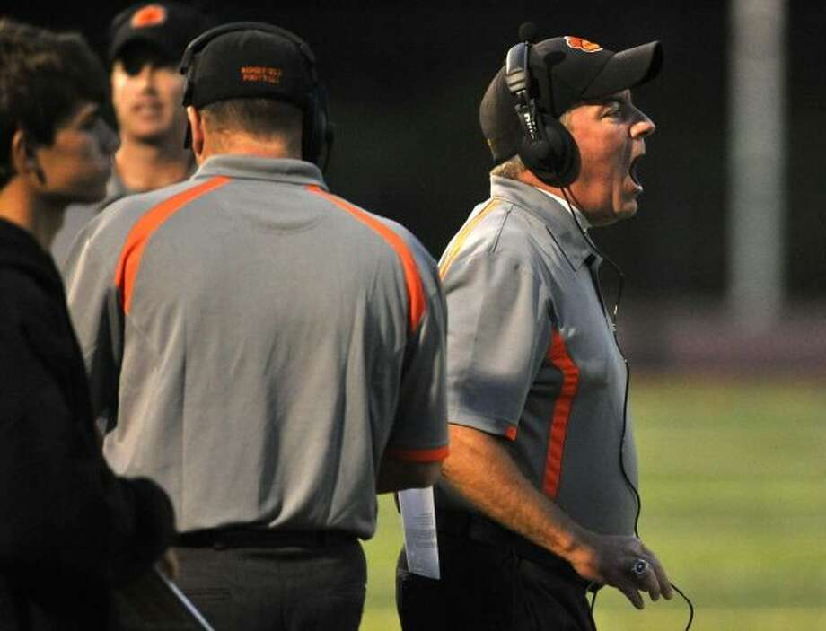 Ridgefield head coach Kevin Callahan shouts orders to his team during their game against Greenwich at Ridgefield High School on Friday, Sept. 14, 2012. Photo: Jason Rearick / News-Times