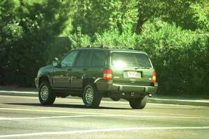 11/4/97. Phoenix, Arizona. Jawad Hashim Who Is Appearing In A Us Bankruptcy Court In Phoenix , Drives Away From The Court In A Luxury $ 37,000 Jeep Cherokee Grand Wagoneer