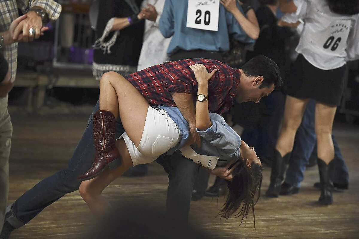 """Kaitlyn Bristowe and bachelor Ben H. engaged in fancy footwork during a Texas two-step competition in Gruene Hall for a San Antonio episode of """"The Bachelorette"""" on ABC in 2015."""