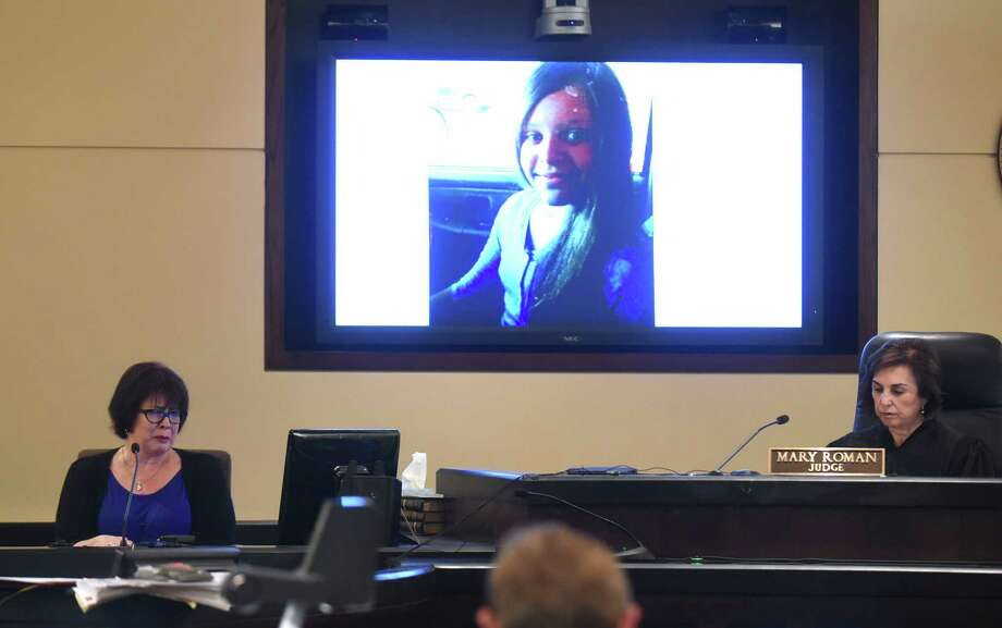 Gina Babineaux holds back tears on the witness stand as a picture of her daughter, Larkspur Elementary School student Tatyana Babineaux, is displayed near Judge Mary Roman on Friday, June 12, 2015. Tatyana Babineaux was killed when hit by a vehicle driven by Isidro Espinosa-Solis in January 2014. Photo: Billy Calzada, Staff / San Antonio Express-News / San Antonio Express-News