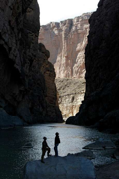 TERLINGUA, TX - JANUARY, 15 - Kyle Crabtree and Cassidy McCaferry from Midland, Texas take in the majesty of the canyon walls as the Rio Grande River flows through Santa Elena Canyon in Big Bend National Park near Terlingua, Texas Sunday Janurary 15, 2012.
